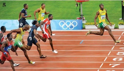 ?? Photos / Getty Images ?? Usain Bolt sprang to prominence by setting a world record despite slowing at the end of the 100m final at the 2008 Beijing Olympics. 5