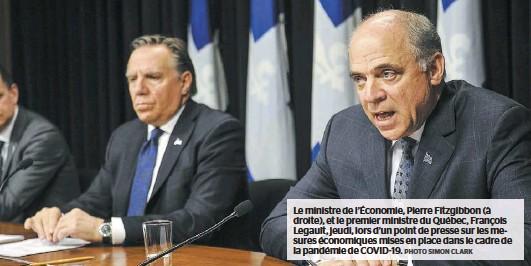 ?? PHOTO SIMON CLARK ?? Le ministre de l'Économie, Pierre Fitzgibbon (à droite), et le premier ministre du Québec, François Legault, jeudi, lors d'un point de presse sur les mesures économiques mises en place dans le cadre de la pandémie de COVID-19.