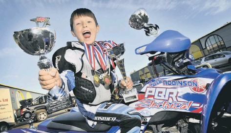 ?? PICTURE: RICHARD PONTER 154505 ?? British Quad XC champion Freddie Robinson celebrates his success