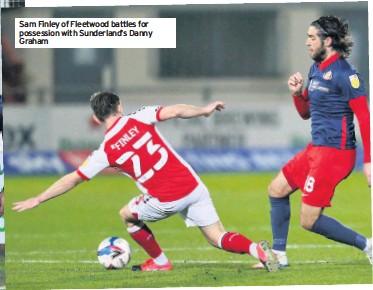 ??  ?? Sam Finley of Fleetwood battles for possession with Sunderland's Danny Graham