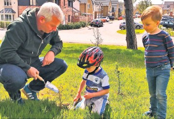 ??  ?? Dig in Residents help to plant the aspen trees on the Dargavel Village green