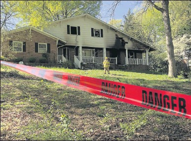 ?? BOB BROWN/TIMES-DISPATCH ?? Chesterfield County fire crews were called just after midnight to this single-family home in the 9900 block of Glass Road, which is located off of Courthouse and Hull Street roads. County officials say the fire early Friday claimed four lives.