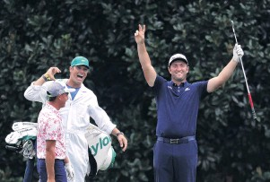 ?? PHOTO: GETTY IMAGES ?? Shot, bro . . . Jon Rahm, of Spain, celebrates with his caddie, Adam Hayes, and fellow player Rickie Fowler, of the United States, after skipping his ball across the lake at the 16th for a hole in one during a practice round yesterday for the Masters at Augusta National Golf Club.