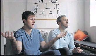 ?? THE ASSOCIATED PRESS ?? Bryan (left) and Bradford Manning, shown in their NewYork City loft, lost much of their vision to a rare degenerative eye disorder. Their clothing company's profits support research to help cure blindness.