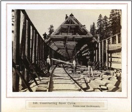 ?? COURTESY OF THE DEPARTMENT OF SPECIAL COLLECTIONS, STANFORD UNIVERSITY LIBRARIES ?? Chinese railroad workers construct a snow cover in the Sierra Nevada foothills while building the Transcontinental Railroad.