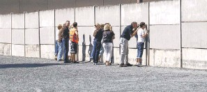 """?? GÜNTER STEFFEN, VISITBERLIN ?? Narrow slits in barriers at the Berlin Wall Memorial provide glimpses of the """"death strip,"""" where those fleeing East Berlin were often gunned down."""