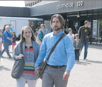 ?? BILL GRAVELAND/THE CANADIAN PRESS ?? David and Collet Stephan come out of the courthouse at the conclusion of closing arguments. They're charged with failing to provide the necessaries of life for their son who died.