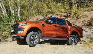 ??  ?? Ce pick-up possède tous les atouts pour s'aventurer en toutterrain. En finition Wildtrak, il se montre particulièrement séduisant. Ford Ranger TDCi 200 ch Double Cab Wildtrak BVA 43 630 € 200 ch CO2 : 234 g/km