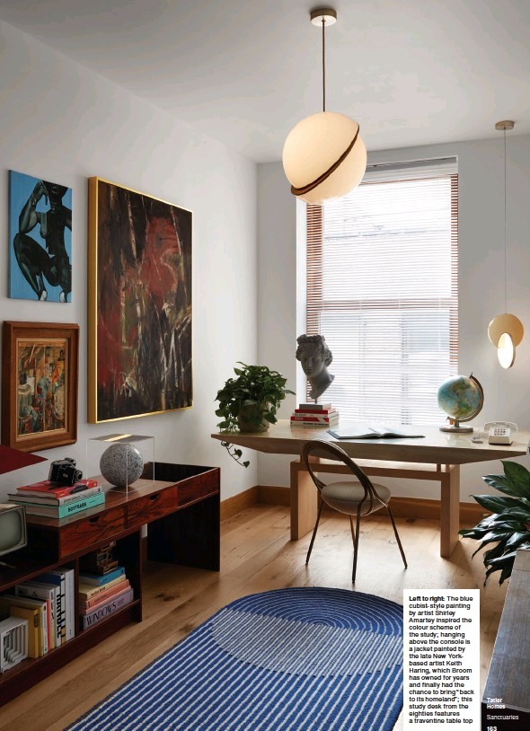 """??  ?? Left to right: The blue cubist-style painting by artist Shirley Amartey inspired the colour scheme of the study; hanging above the console is a jacket painted by the late New Yorkbased artist Keith Haring, which Broom has owned for years and finally had the chance to bring """"back to its homeland""""; this study desk from the eighties features a traventine table top"""