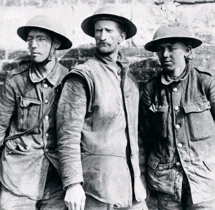 ??  ?? Three British soldiers taken prisoner in spring 1918. Such PoWs repeatedly expressed their absolute confidence in the British Army's martial ability