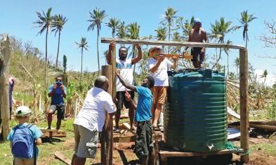 ?? Photo: Sea Mercy Fiji ?? Sea Mercy Fiji team with villages helping restore drinking water.