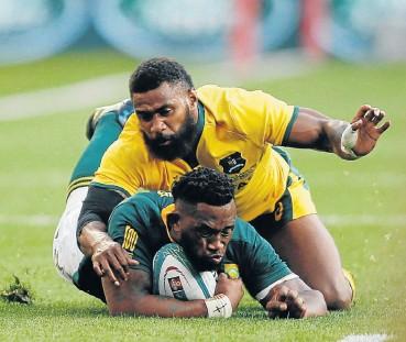 ?? Picture: Siphiwe Sibeko/Reuters ?? Springbok captain Siya Kolisi is tackled by Australia's Marika Koroibete in yesterday's Test match.