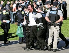 ?? /Asanka Ratnayake/Getty Images ?? Nabbed: A protester is taken away by police at the Shrine of Remembrance in Melbourne, Australia, during a protest against lockdown restrictions on September 22 2021.