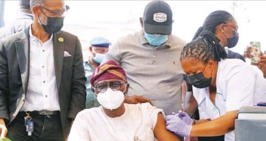 ??  ?? Governor Sanwo-Olu of Lagos State taking his first Covid-19 vaccine jab during the roll out exercise in Lagos.