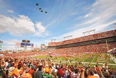 ?? BRIAN BLANCO/ASSOCIATED PRESS FILE ?? In this 2009 photo, Tampa Bay fans fill their stadium and cheer during a military fly-over before the Buccaneers played the Green Bay Packers. Because of the pandemic, the stadium will be only one-third full for this year's Super Bowl.