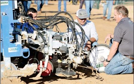 ?? Buy these photos at YumaSun.com PHOTOS BY RANDY HOEFT/ YUMA SUN ?? MARK SIEMENS (RIGHT), WITH THE UNIVERSITY OF ARIZONA YUMA AGRICULTURAL CENTER, talks about the automated in-row cultivator Wednesday morning at the 2017 Southwest Agriculture Summit on the Arizona Western College main campus.