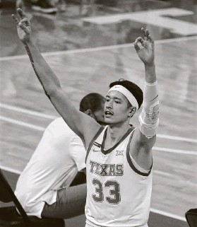 ?? Chuck Burton / Associated Press ?? UT's Kamaka Hepa celebrates after a teammate's 3-pointer against Kansas State on Saturday in Austin. Hepa himself hit 5 of 8 3-pointers in the win.