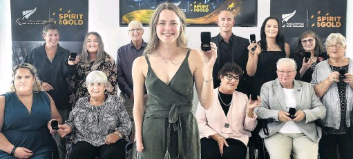 ?? PHOTO: PETER MCINTOSH ?? Southern gold . . . Anna Grimaldi (front), of Dunedin, shows off her Paralympics New Zealand numbered pin, awarded last night, with fellow Paralympians (front row, from left) Jessica Gillan, of Dunedin, Patricia Hill, of Oamaru, Denise Gow, of Dunedin, Margaret Lean, of Dunedin, representing her dead husband Bill, and Miriam Read, of Dunedin, representing her dead husband Philip, Tanya Bradley (back left), of Invercargill, Caitlin Dore, of Christchurch, Neal Marett, representing his dead brother Graeme, of Geraldine, Carl Murphy, of Wanaka, Holly Robinson, of Dunedin, and Jenny Newstead of Dunedin, at the Celebration Project in Dunedin. Henk Dijkstra, of Dunedin, was absent.