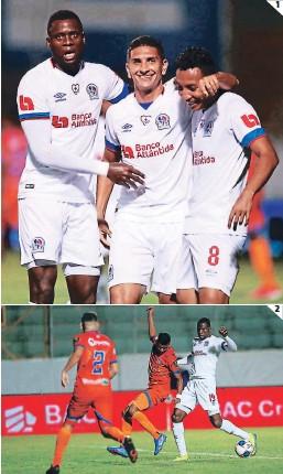 ?? FOTOS: EMILIO FLORES ?? (1) Yusting Arboleda, Johnny Leverón y Allan Banegas. (2) El ariete colombiano Arboleda fue un dolor de cabeza para la zaga naranja.