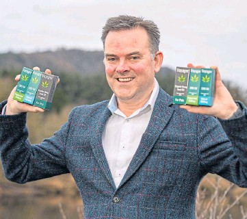 ??  ?? GROWTH: Nick Tulloch, Voyager chief executive, with some of the firm's CBD products.