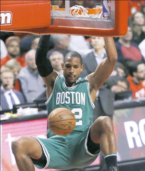 ?? Charles Rex Arbogast/Associated Press ?? Al Horford dunks against Chicago in the second half of Game 3 of the Celtics-Bulls first-round playoff series Friday night.