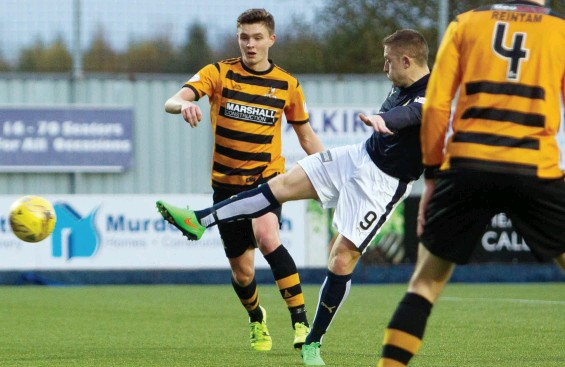 ??  ?? Treble tops: Baird drills in his third goal against Alloa on Saturday, leading team-mate McHugh to hail him the best striker in the Championship
