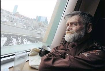 ?? gavin Young, Calgary Herald ?? Terry Pettigrew looks out the window in his room at the calgary drop-In centre. The 58-year-old homeless man is dying of cancer, and the shelter's staff has said it will do its best to honour his wish to die at the shelter.