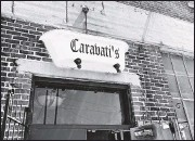 ?? GREGORY J. GILLIGAN/TIMES-DISPATCH ?? A tub bearing the Caravati's name hangs above the entrance to the Richmond architectural salvage business.