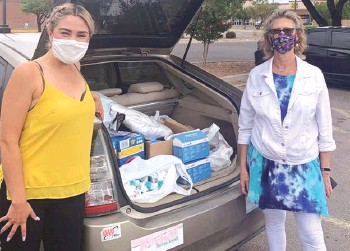 ??  ?? Barbara Gabioud (right) gathers supplies for people in need across the border.
