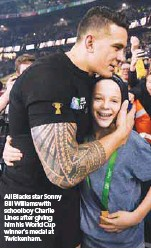 ??  ?? All Blacks star Sonny Bill Williams with schoolboy Charlie Lines after giving him his World Cup winner's medal at Twickenham.