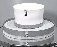 ??  ?? The Soul Mate deep bowl combines ivory earthenware ceramic with a cork base. It is displayed atop an Aro bowl of cork surrounded by a steel band.