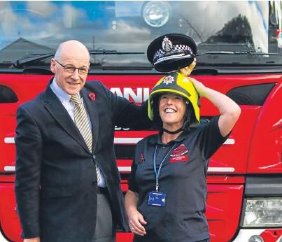 ??  ?? MSP John Swinney with safer communities warden Norma Carr in Aberfeldy.