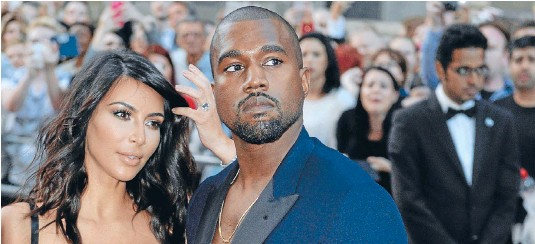 ??  ?? Now he ain't sayin' she a gold digger . . . but rapper Kanye West reportedly did get a prenup when he married reality TV star Kim Kardashian last year.