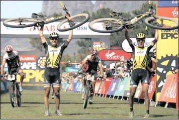 ?? PICTURE: EPA ?? EPIC: Swiss Nino Schurter, left, and Matthias Stirnemann of SCOTT-SRAM MTB Racing celebrate winning the Cape Epic mountain bike stage race, Paarl. The race is called the 'Tour de France' of mountain biking.