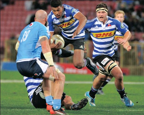 ?? Picture NOOR SLAMDIEN ?? HIGH HOPES: Western Province's Damian Willemse goes airborne as he tries to evade the Bulls defence .