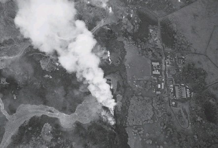 ?? BRUCE OMORI/PARADISE HELICOPTERS/EPA-EFE/SHUTTERSTOCK ?? The Puna Geothermal Venture facility, seen this week in Pahoa, Hawaii, is being threatened by lava oozing from fissures at the base of the Kilauea volcano. An increase in eruptions this spring has led to the destruction of dozens of homes and has...