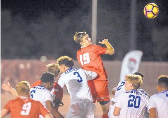 ?? ROBERTO E. ROSALES/JOURNAL ?? New Mexico's Matthew Constant (19) tries a header Saturday night against visiting Kentucky. The 13th-ranked Wildcats won 1-0, ending UNM's 14-game home unbeaten streak.