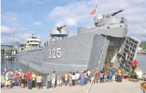 ?? STAFF FILE PHOTO ?? People waiting in line to board the USS LST-325 on a previous visit to Chattanooga. The World War II landing ship is docked at Ross's Landing through Tuesday, Aug. 27.