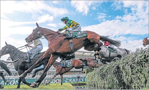 ??  ?? Minella Times ridden by Rachael Blackmore clears the water during the Grand National at Aintree yesterday Picture: David Davies/pa
