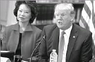 ?? Evan Vucci/The Associated Press ?? President Donald Trump, with Transportation Secretary Elaine Chao, met with business leaders Tuesday to discuss infrastructure and regulations.