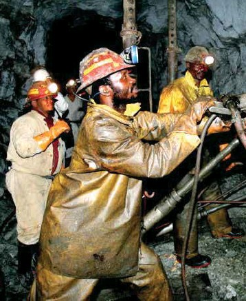 ??  ?? HARD AT WORK: Lesotho mine workers at a South African gold mine