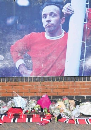 ?? PHOTO: REUTERS ?? Another 1966 hero gone . . . Tributes lie outside Old Trafford for former Manchester United and England footballer Nobby Stiles.