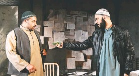 """?? STAN BAROUH ?? Ahmad Kamal, left, and Maboud Ebrahimzadeh are part of an excellent cast in """"The Invisible Hand"""" at Olney through June 10."""