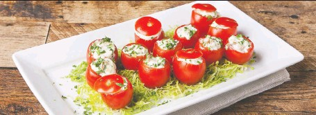 ?? PHOTOS: ATCO BLUE FLAME KITCHEN ?? These tiny tomatoes take some effort to stuff with a bacon and cheese filling, but the end result is worth it.