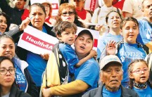 ?? RICH PEDRONCELL­I/ASSOCIATED PRESS ?? Oralia Sandoval, center, holds her son Benjamin, 6, at the Immigrants Day of Action rally on May 20 in Sacramento.