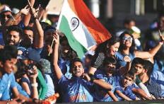 ?? AFP ?? ■ Indian fans jubilating during the Twenty20 match against Australia at Sydney Cricket Ground on November 25.