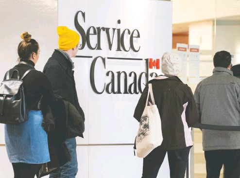 ?? PAUL CHIASSON / THE CANADIAN PRESS ?? Canadians who received Employment Insurance or other federal COVID-19 financial benefits will have a year to repay tax debts owing for 2020.