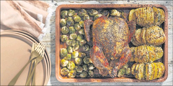 ?? TOMMCCORKLE FOR THEWASHINGTON POST ?? Easy and budget-friendly Sheet Pan Chicken with Hasselback Potatoes and Brussels Sprouts scales back the traditional multicourse Thanksgiving feast but retains its cheer.