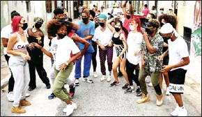?? AFP ?? The troupe jumps and gyrates to the reggaeton rhythm in sports clothes and sneakers, dyed hair and bandannas as they are watched by a ragtag group of neighborhood kids in a poor district of central Havana.