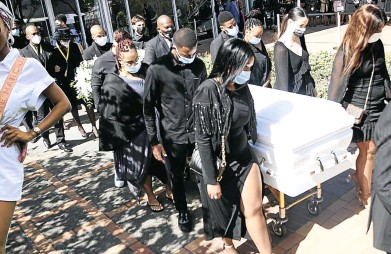 ?? Picture: Khaya Ngwenya ?? Friends and relatives escort the body of Nelli Tembe at her funeral at ICC in Durban.